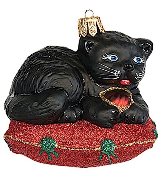 Katze schwarz auf Polster